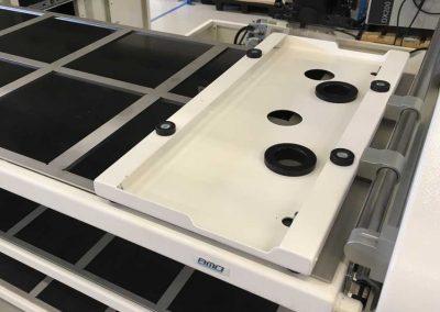Optionale Palettenwechselstation von BMO Automation im oberen Einschub der Schubladenspeicher